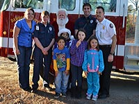 Dawson Emergency Services and Santa visit Dawson Family